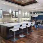 Fabulous light gray room Contemporary Kitchen in Kansas City with pendant lights and white kitchen