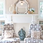 Glorious faux bois mirror Traditional Living Room in Austin with white garden stool and