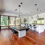 Wonderful light gray room in with black modern chairs and dining design