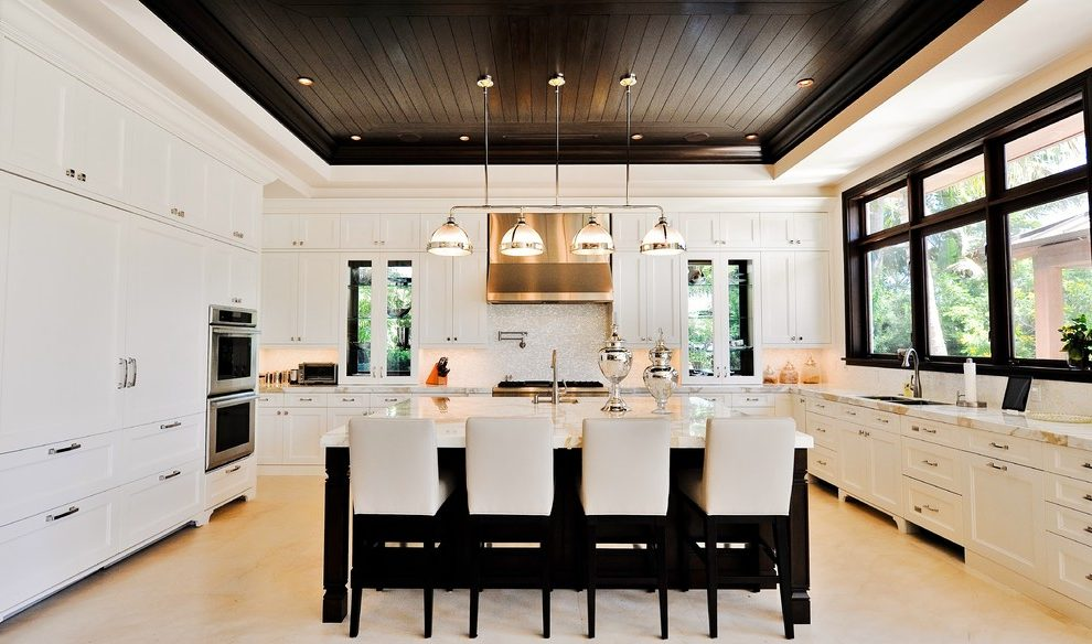 Magnificent quartz countertops that Traditional Kitchen in Miami with kitchen island and dark ceiling