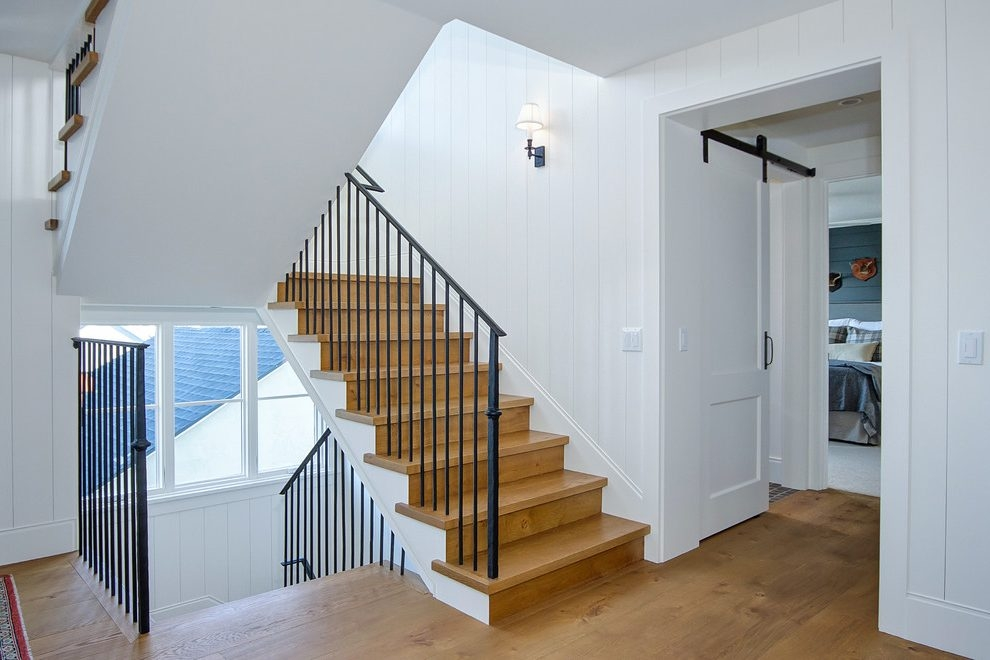 Orange County Wall Mounted Handrail Staircase Farmhouse Staircase | Black Banister With White Spindles | Brazilian Cherry Stair | Victorian | Traditional Home | Iron Spindle White Catwalk Brown Railing | Gray