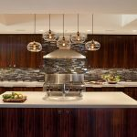 White Countertops And Undermount Sink Appliance Wall Blown Glass Pendant Lights Chimney Hood Dark Wood Cabinets Kitchen Double Ovens Flat Panel Gas