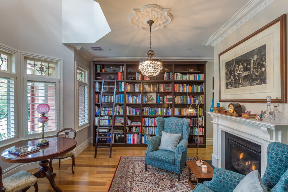 Espresso Ladder Bookshelf Traditional Family Room Stained Glass Windows And Ceiling Medallion Bay Window Blue Wingback Armchairs Ceiling Medallion Crown Molding Rolling Library Ladder Stained Glass