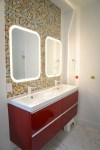 Good-Looking Floating Bathroom Cabinets Designing Tips with High Gloss Cabinet and Lighted Mirror