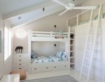 Lovely Custom Bunk Bed Kids Beach Style with Under-bed Storage White Circular Window Ceiling Fan Summer House Wicker Pouf Rope Railing Striped Rug