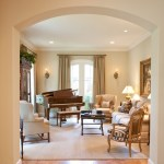 Lovely French Sofa Family Room Traditional with Arch Doorway Wingback Chair Bergu00e8re Oil Painting Baby Grand Sitting Room Doors Table Lamp Piano Formal Living French Country