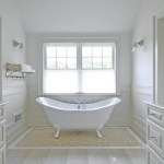 Pleasing Glass Bath Canisters Bathroom Beach Style With White Wall And White Paneling Beige Tile Floor Claw-foot Tub Double Vanity Natural Light Lighting Towel Rack Wall Sconce White Bathroom Cabinets