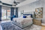 Splendid Blue and Gray Bedroom Contemporary Wayne interiors Bedrooms with Accents Bedding Armchair Nailhead Headboard Curtains Accent Mirror Tray Ceiling Tufted Headboard