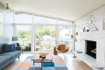 Terrific Sunburst Wall Clocks Living Room Midcentury with Clock White Painted Brick Sloped Ceiling Coffee Table Lots Of Natural Light Lots Windows