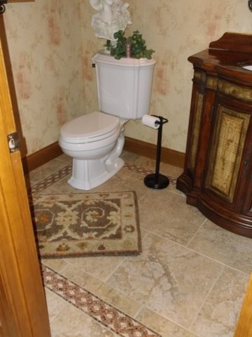 Wonderful Faux Tile Wallpaper Powder Room Traditional With Ceramic Tile Floor And Dark Wood Vanity Beige Ceramic Tile Floor Floral Wallpaper Bow Front Vanity Dark Wood Furniture Style Medium Baseboard