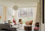 Blooming Leopard Dining Chairs Living Room Contemporary with Cowhide Chair Red Accents Coffee Tables Globe Fixture Midcentury Modern Lots Of Light Natural Floor To Ceiling Windows Grey
