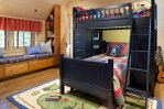 Impressive Pottery Barn Boys Room Kids Traditional with Window Seat Vaulted Ceiling Pirate Quilt Bedroom L-shaped Bunk Beds Built-in Bookshelves Activity Rug Under Bench Storage Cushions