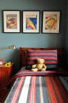 Beautiful Boys Red Bedding Kids Eclectic with Framed Art Kids' Rooms Wood Bed Frame West Coast Blue Painted Walls Bedside Table Swing Arm Lamp