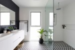Pleasing Black and White Shower Tile Bathroom Contemporary with White Drop in Sinks Flat Panel Floating Vanity Herringbone Backsplash Walls His Hers Sinks Glass Partition