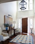Pleasing Console Table Entry Traditional with Foyer Lighting Fixture Front Door Sidelites Lots Of Natural Light Striped Arm Chair Wood Tall Windows Umbrella