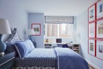 Sparkling Monochromatic Bedroom Transitional Boy's Bedroom with Blue and White Bedding Built in Desk Black Dresser Red Framed Art Blue Shades