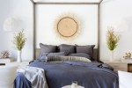 Wonderful Nautical Bedroom Accessories Bedroom Beach Style with Casual Elegance Rattan Wall Decor Lighting Pendants Beach Home Dark Gray Bedding Floral Arrangement Stacked Books