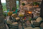 Good-Looking Rustic Fireplace Designs Patio Rustic with Lakefront Lodge Mountain Home Designers Cabin Luxury Stone Outdoors Lake Front indoor-outdoor Exterior Stacked