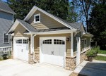 Pretty Taupe Color Walls Garage Traditional with Neutral Colors Potted Plants Concrete Paving Container Outdoor Lighting Wood Siding Metal Roof Outbuilding Detached Garage Doors Carriage