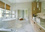 Terrific Sheep Skin Rug Bathroom Contemporary with Window Shutters Window Treatments Neutral Colors Wood Cabinets Pendant Lighting Monochromatic Roman Shades Marble Countertops Freestanding Tub Square