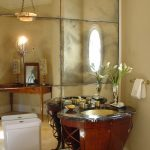 Good-looking Antiqued Mirrored Furniture Powder Room Traditional With Vanity With Stone Top And Brass Sink Antiqued Mirror Brass Sink Brown Countertop