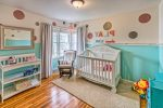 Impressive Aqua and Orange Nursery Nursery Traditional with Polka Dots White Changing Table Crib Blue Walls Natural Fiber Rug On Wall Rocking Chair Wood Floors Gray Curtains