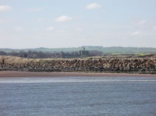 The breakwater at Amble designed by Grandad C with Warkworth Castle in the background.