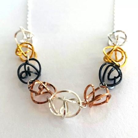 Victoria Johnson - multi coloured tangle necklace