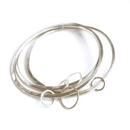 Julia Wright - Three silver bangles.