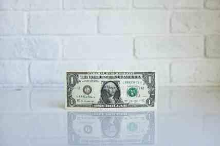 dollar bill on counter top