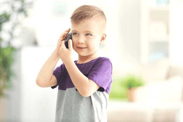 Little boy alone on the phone