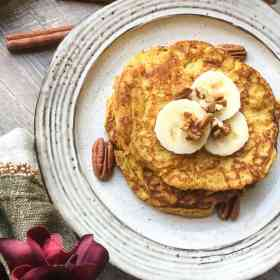 easy gluten-free pancakes topped with banana slices and nuts