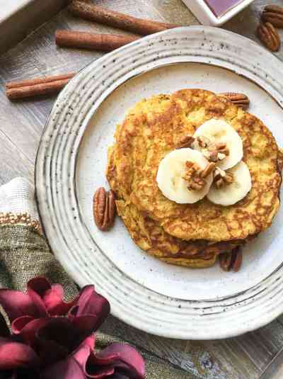 easy gluten-free, paleo-friendly pancakes topped with banana slices and nuts