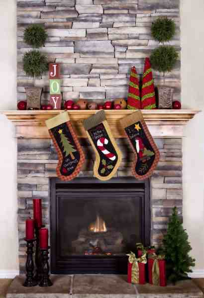 Adding a festive touch like stockings and decorations around a fireplace mantle is one of 9 hacks for how to prepare your home for holiday guests