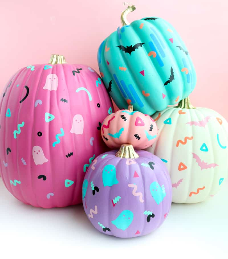 pumpkins decorated with paint and stickers
