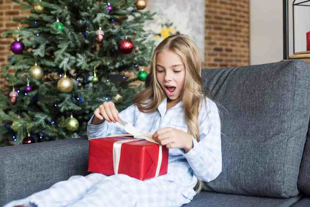 girl opening holiday present