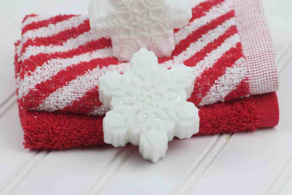 snowflake DIY soap bar on red and white towels