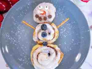 cinnamon roll snowman on a plate
