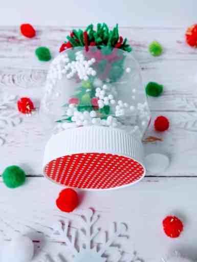 mason jar snow globe on a table