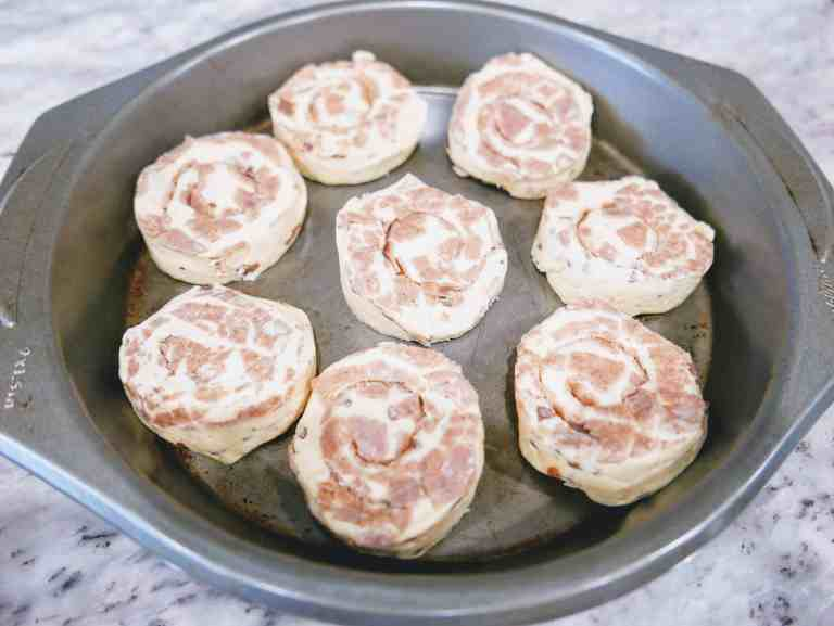uncooked cinnamon rolls in pan