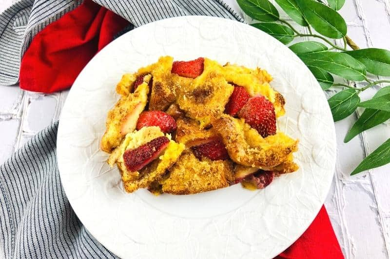 strawberry french toast casserole slice on a plate