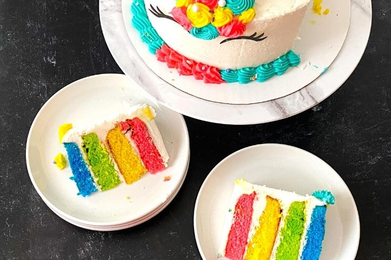 slices of rainbow layered cake from above