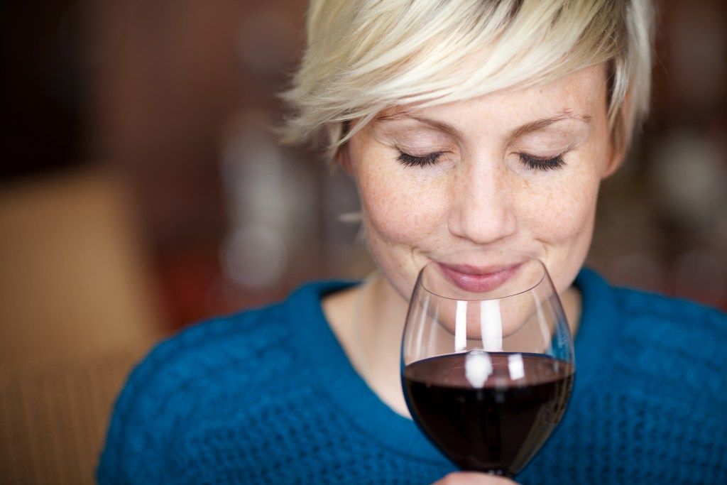 woman sipping a glass of wine
