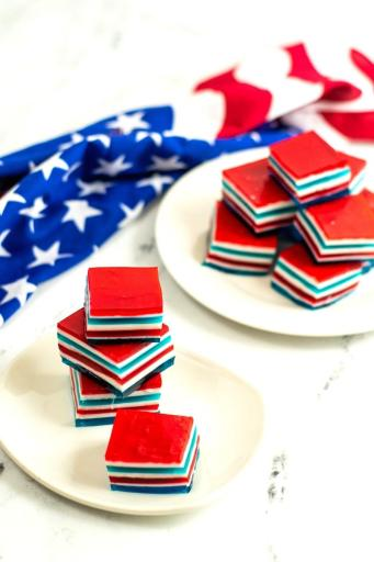 stacked red white and blue jello squares on plates