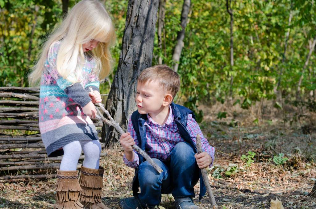 two kids fighting - playing together is an example of good impulse control activities for kids