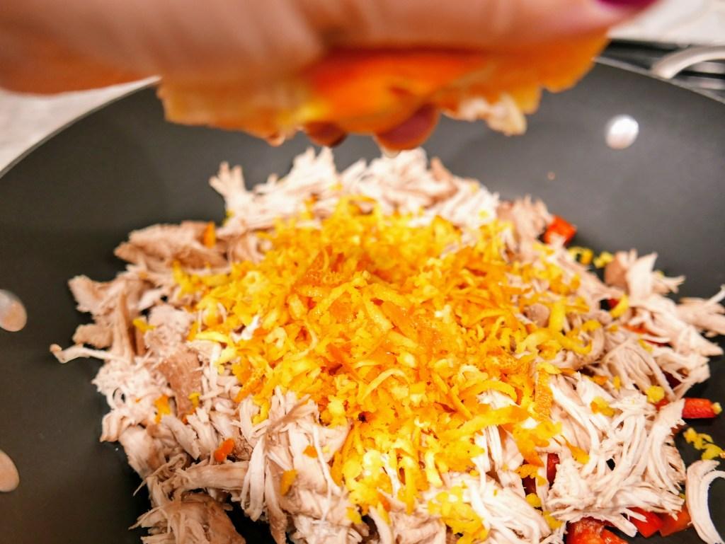 shredded chicken with veggies and orange peel
