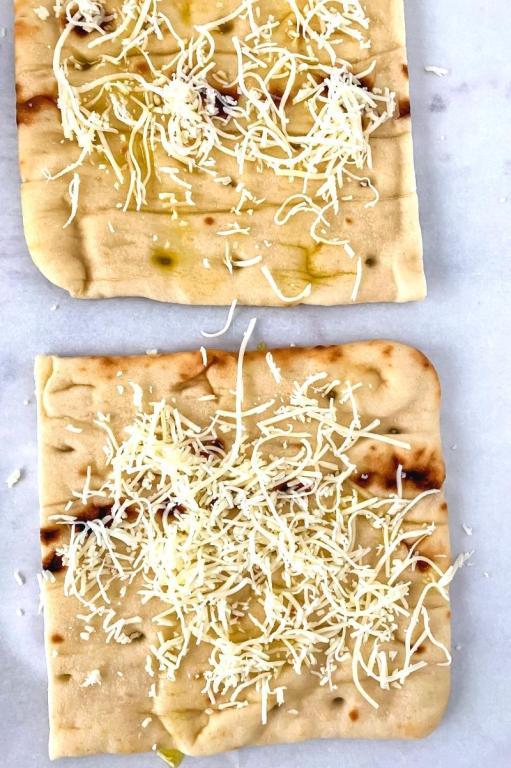 cheese on cut flatbread
