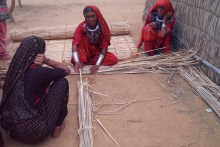 The Jat women build their homes using grass and straw.