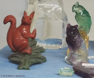 German Family of Carvers carving a squirrel, owl and parrot into fluorite