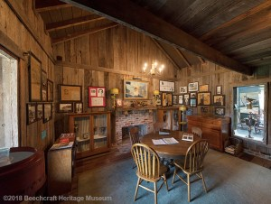Louise Thaden Library - re-created log cabin with pictures all over the walls and a table to sit down and read through all of the documents in the collection